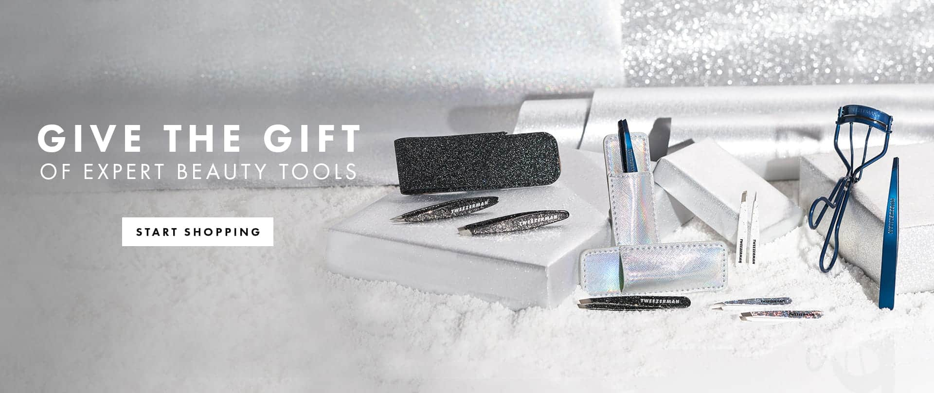 A collection of Tweezerman's holiday beauty tools featuring tweezers, curlers and gift sets in festive patterns.